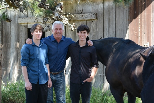 William Ostrander with sons, Bruno, 19, left, and Jack, 16, right, and horses Cheetah and Raven