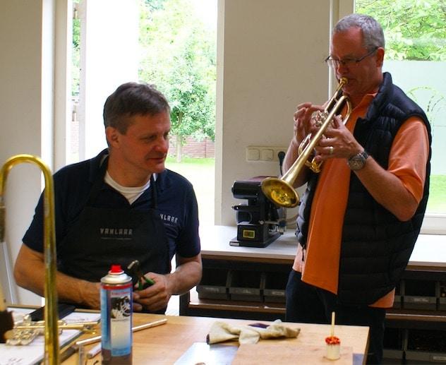 Horn maker Hub van Laar (seated) & Star Wars First Trumpet, Jon Lewis, with Van Laar's instrument.