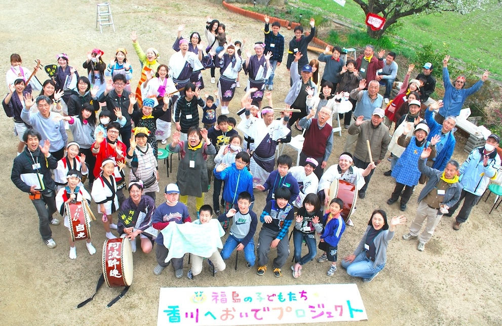 Satoko Watanabe and volunteers welcome Fukushima children and their mothers for a spring camp.