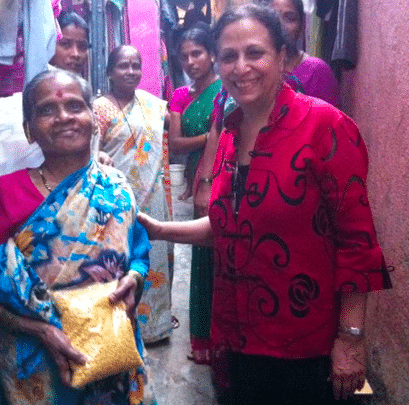 Geeta Mehta with resident in Dharavi involved with Social Capital Credits. There are 600,000 people living in Dharavi in roughly 90 distinct neighborhoods. These people supply the city with labor and inputs for industry, contributing 1 billion dollars into Mumbai's economy.