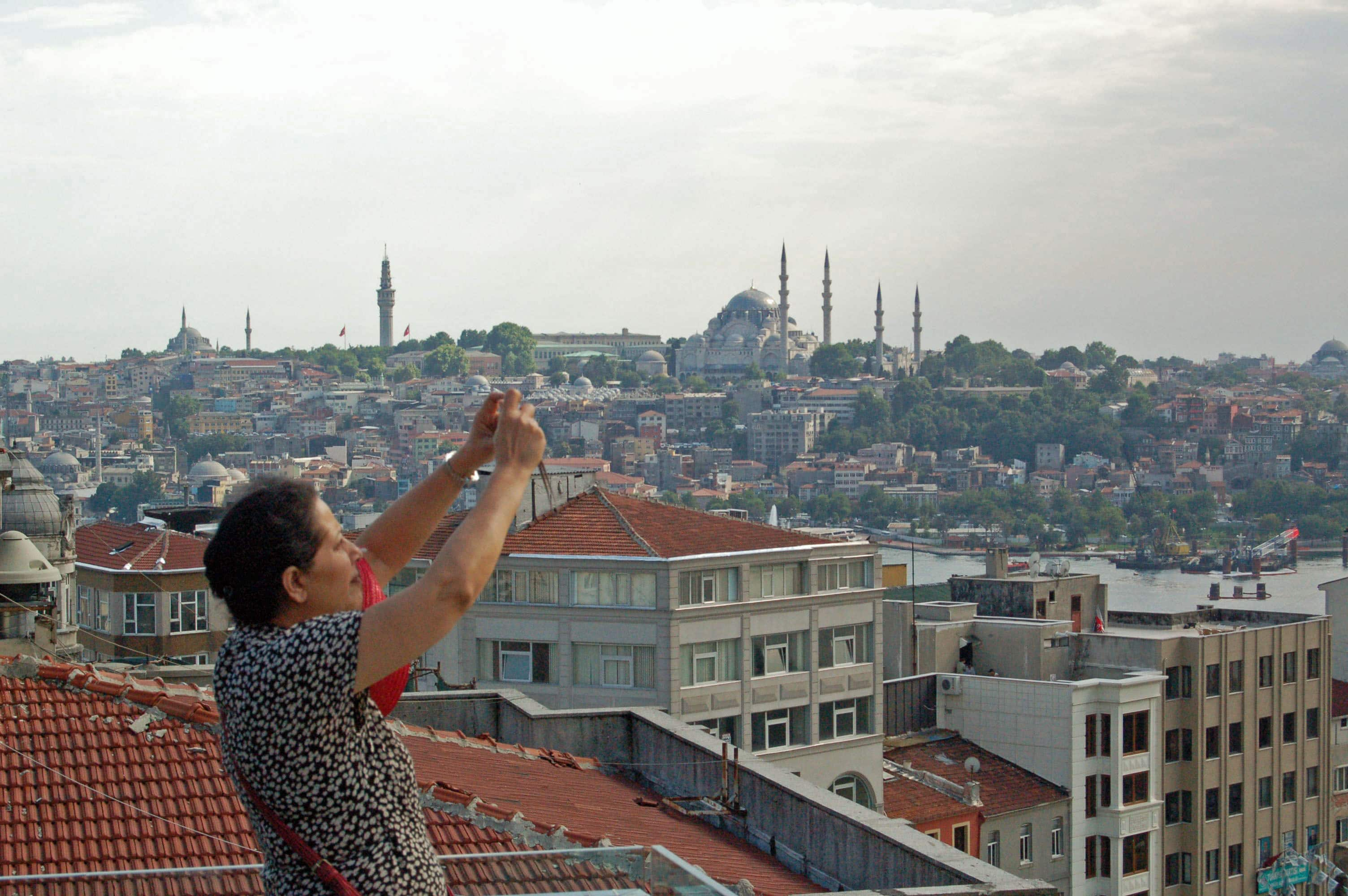 Geeta Mehta taking photos of Istanbul, Turkey while working with local groups demonstrating social capital of communities.