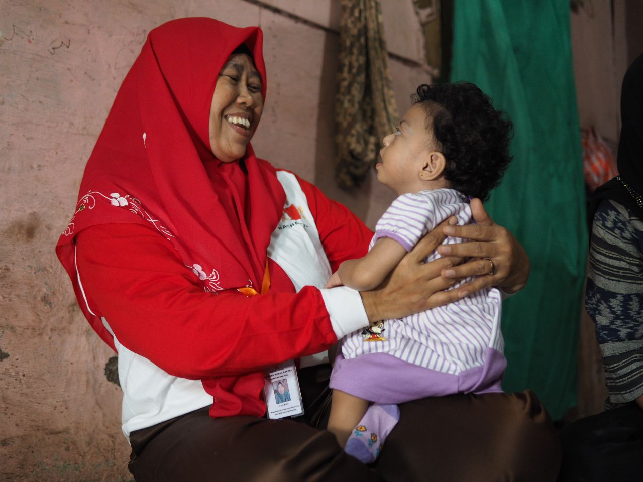 Rachel House Community-Based Palliative Care volunteer with patient. Photo by Kartika Kurniasari.