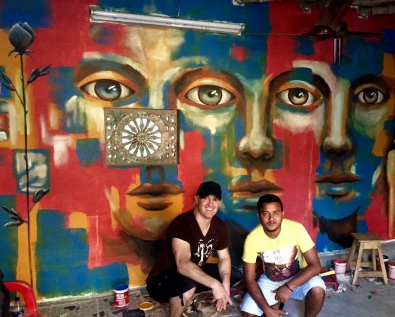 Gus Harper with Akash, tuk tuk driver, in front of the club in Santiniketan, India.